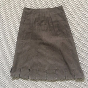 A-line fawn brown skirt, detailed hem, red lining